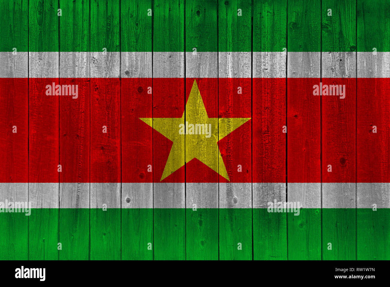 Suriname flag painted on old wood plank. Patriotic background. National flag of Suriname - Stock Image