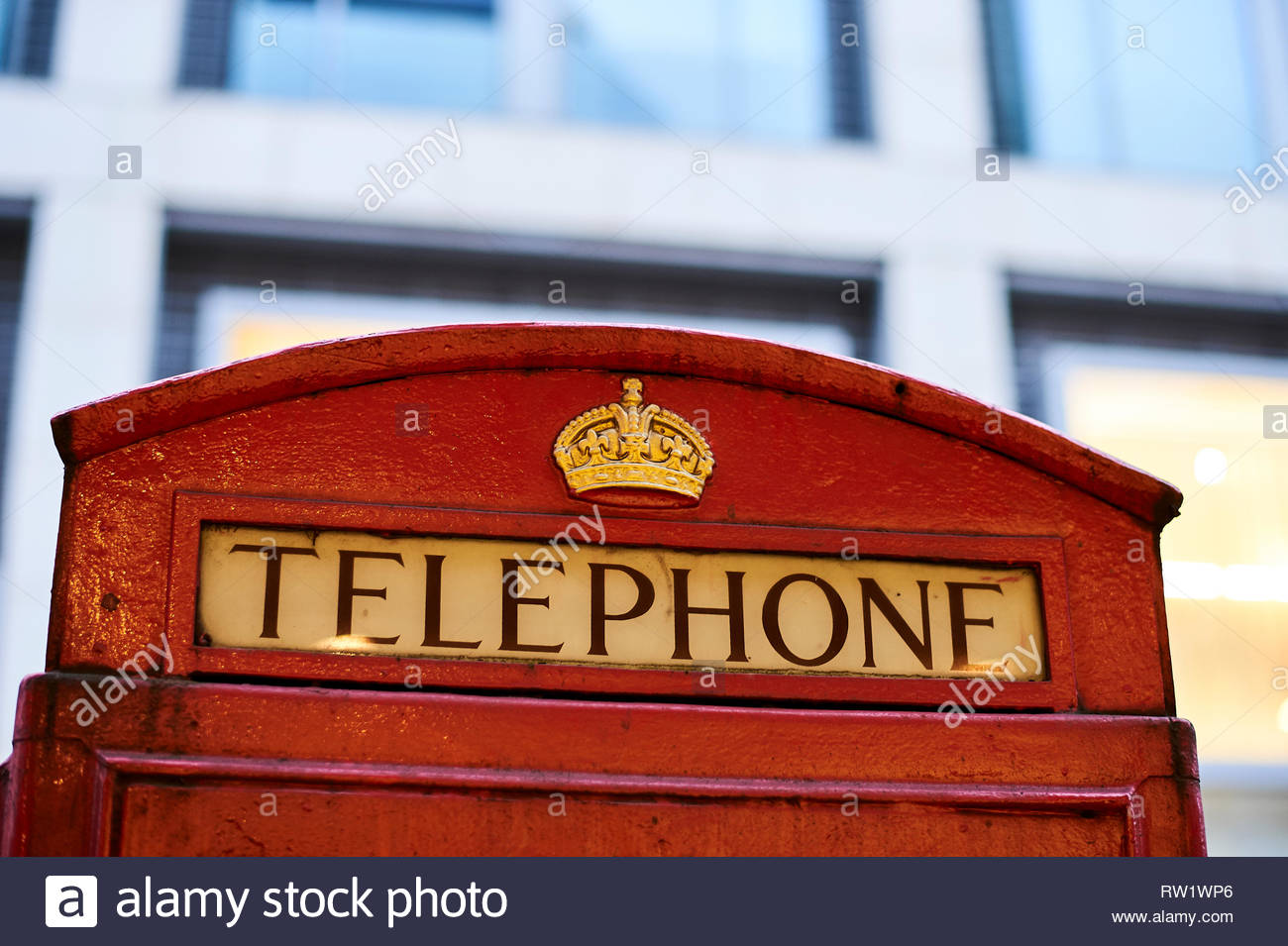 Red Telephone Box  on Oxford Street in London - Stock Image