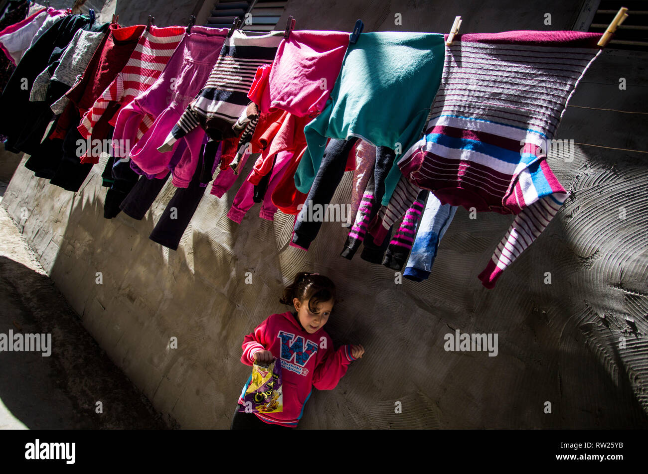 Gaza, Palestine. 4th Mar 2019. A Palestinian girl seen standing near their house at the Jabalya refugee camp in the northern Gaza Strip. With high rates of unemployment and lack of job opportunities in Gaza, an increasing number of families are facing poverty after losing work during the last 12-year blockade on Gaza. Credit: SOPA Images Limited/Alamy Live News Stock Photo