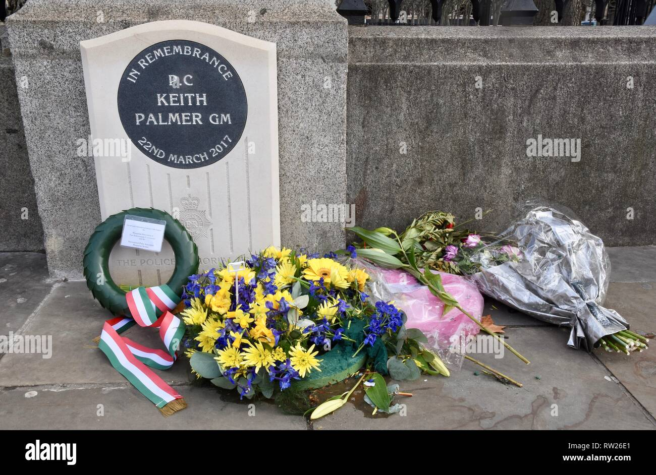 4th Mar 2019. Bouquets continue to be laid at the new memorial to PC Keith Palmer as we approach the second anniversary of his death in the Westminster Bridge Terror Attack on 22.03.2017.Houses of Parliament,Westminster,London.UK Credit: michael melia/Alamy Live News - Stock Image
