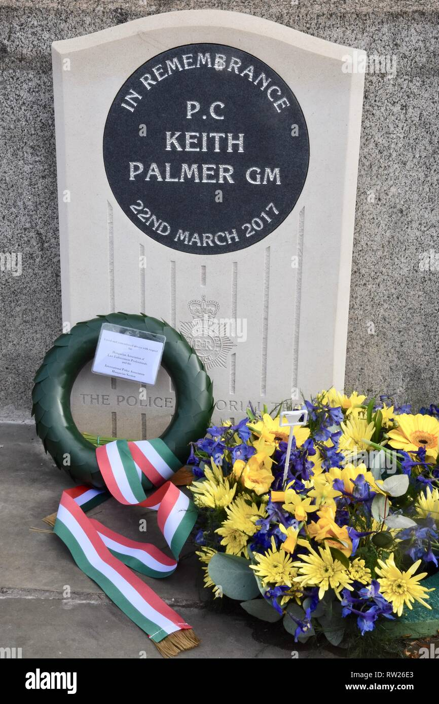 4th Mar 2019. Bouquets continue to be laid at the new memorial to PC Keith Palmer as we approach the second anniversary of his death in the Westminster Bridge Terror Attack on 22.03.2017.Houses of Parliament,Westminster,London.UK Credit: michael melia/Alamy Live News Stock Photo