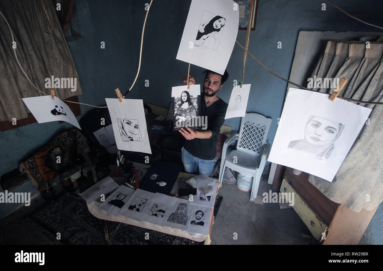 March 3, 2019 - Gaza, ???? ???????/????, Palestine - Mahmoud Abu Assi, 20, a Palestinian artist who supports his family as a painter and calligrapher at his home in Gaza City, in the absence of job opportunities and the worsening economic situation and the siege at the Gaza Strip. Credit: Yousef Masoud/SOPA Images/ZUMA Wire/Alamy Live News - Stock Image