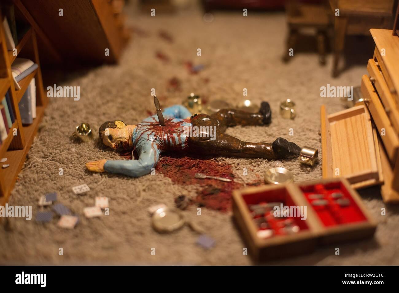 Close up detail of a diorama of a murder scene, at the Peculiarium in Portland, Oregon, USA. - Stock Image
