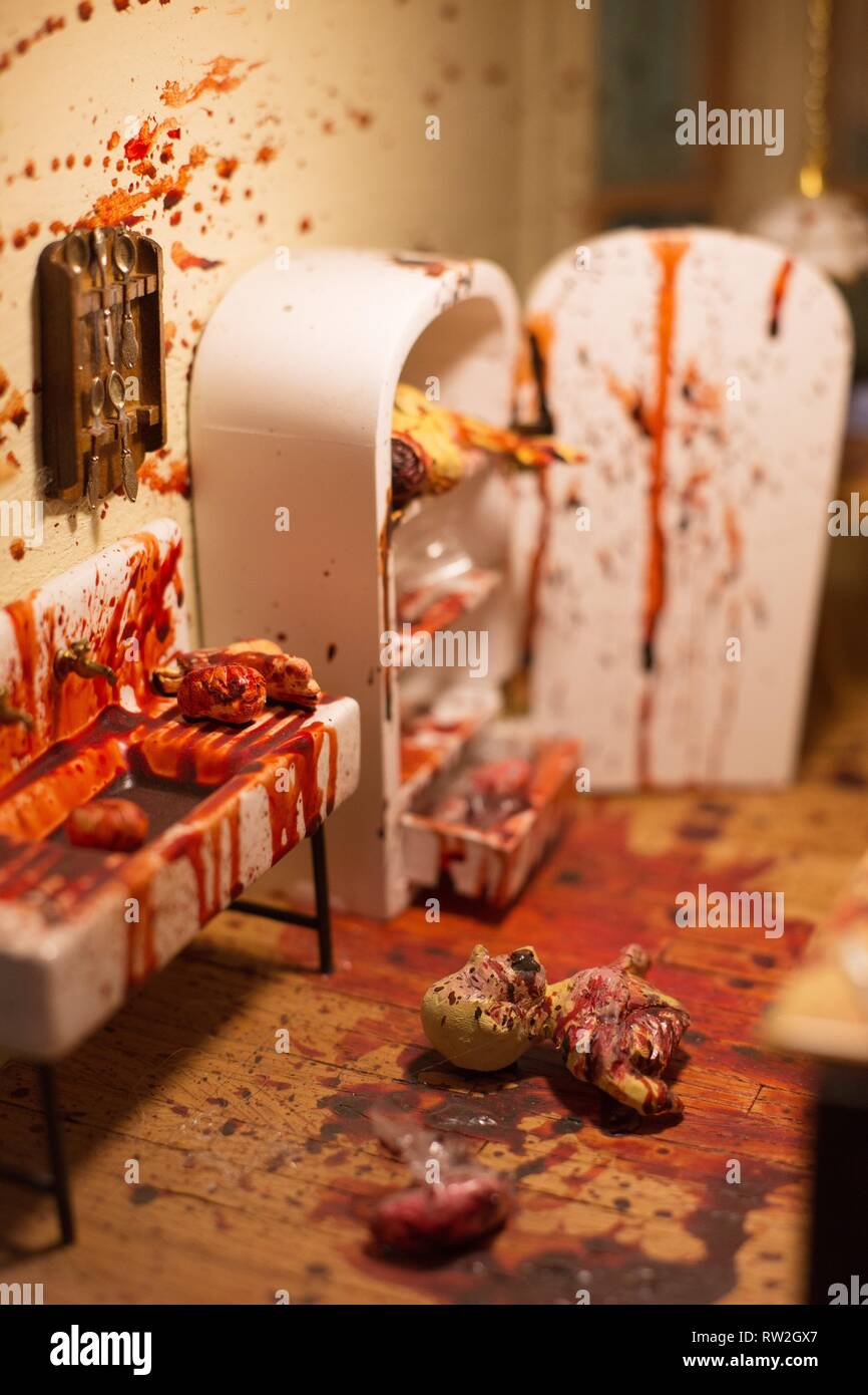 Close up of a diorama of a murder and body parts, on display at the Peculiarium in Portland, Oregon, USA. - Stock Image