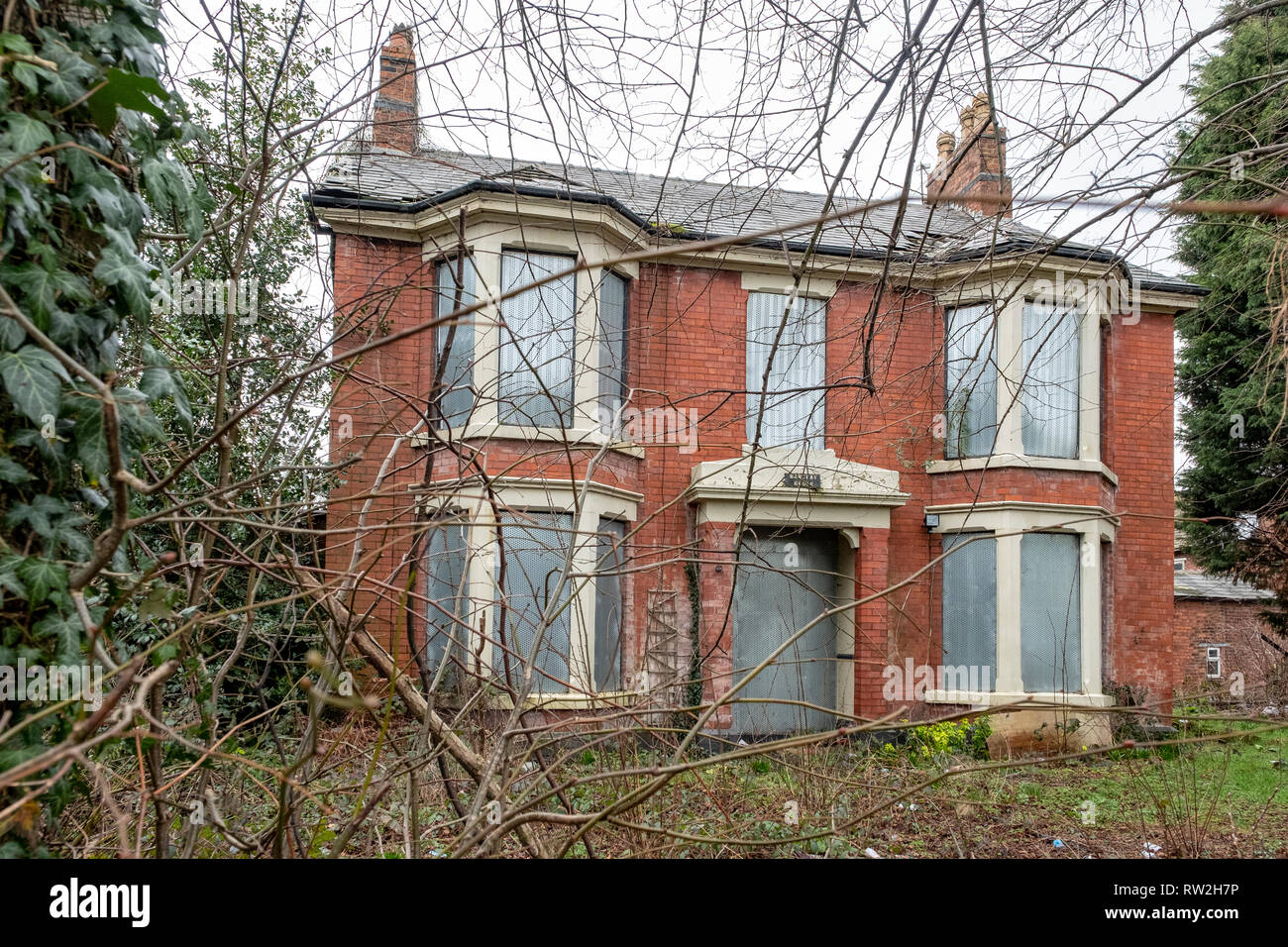 Derelict and boarded up Barclay House in Middlewich Cheshire UK - Stock Image