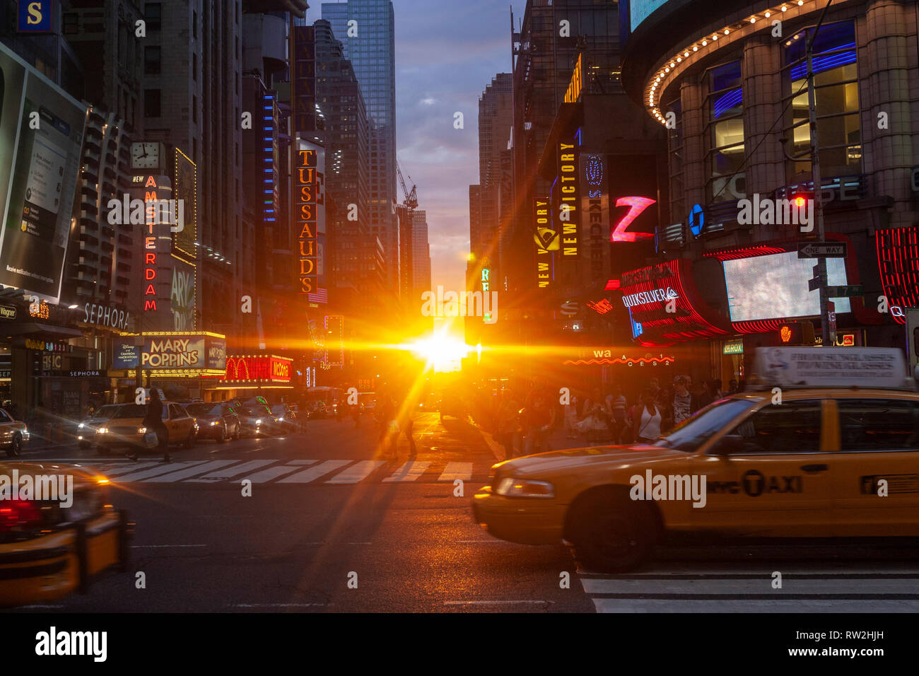 Yellow taxis in W 42nd St at sunset near Times Sq, Manhattan, New York City, USA - Stock Image