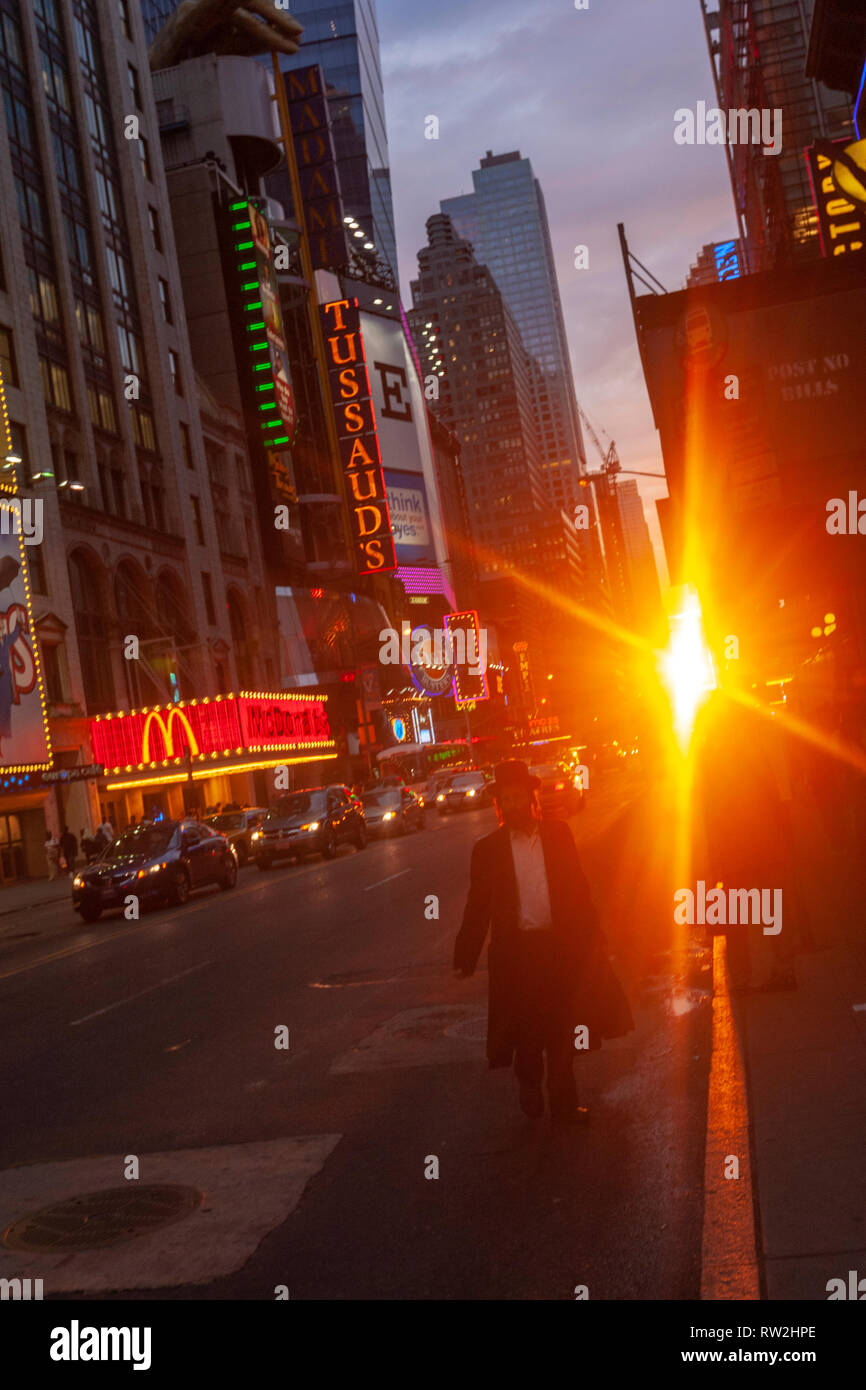 Jewish person walking in W 42nd St at sunset near Times Sq, Manhattan, New York City, USA - Stock Image
