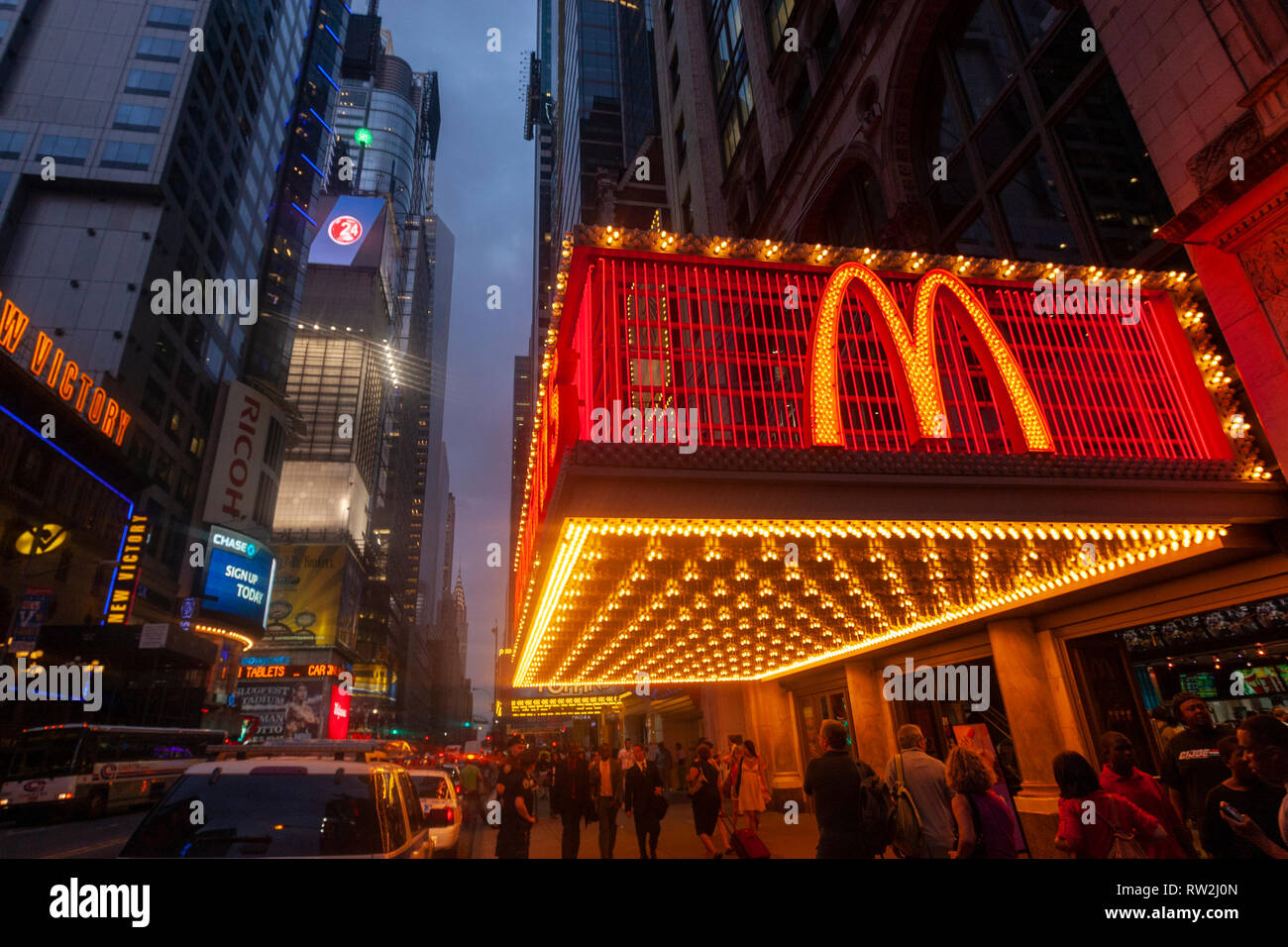 McDonald's in W 42nd St at sunset near Times Sq, Manhattan, New York City, USA - Stock Image