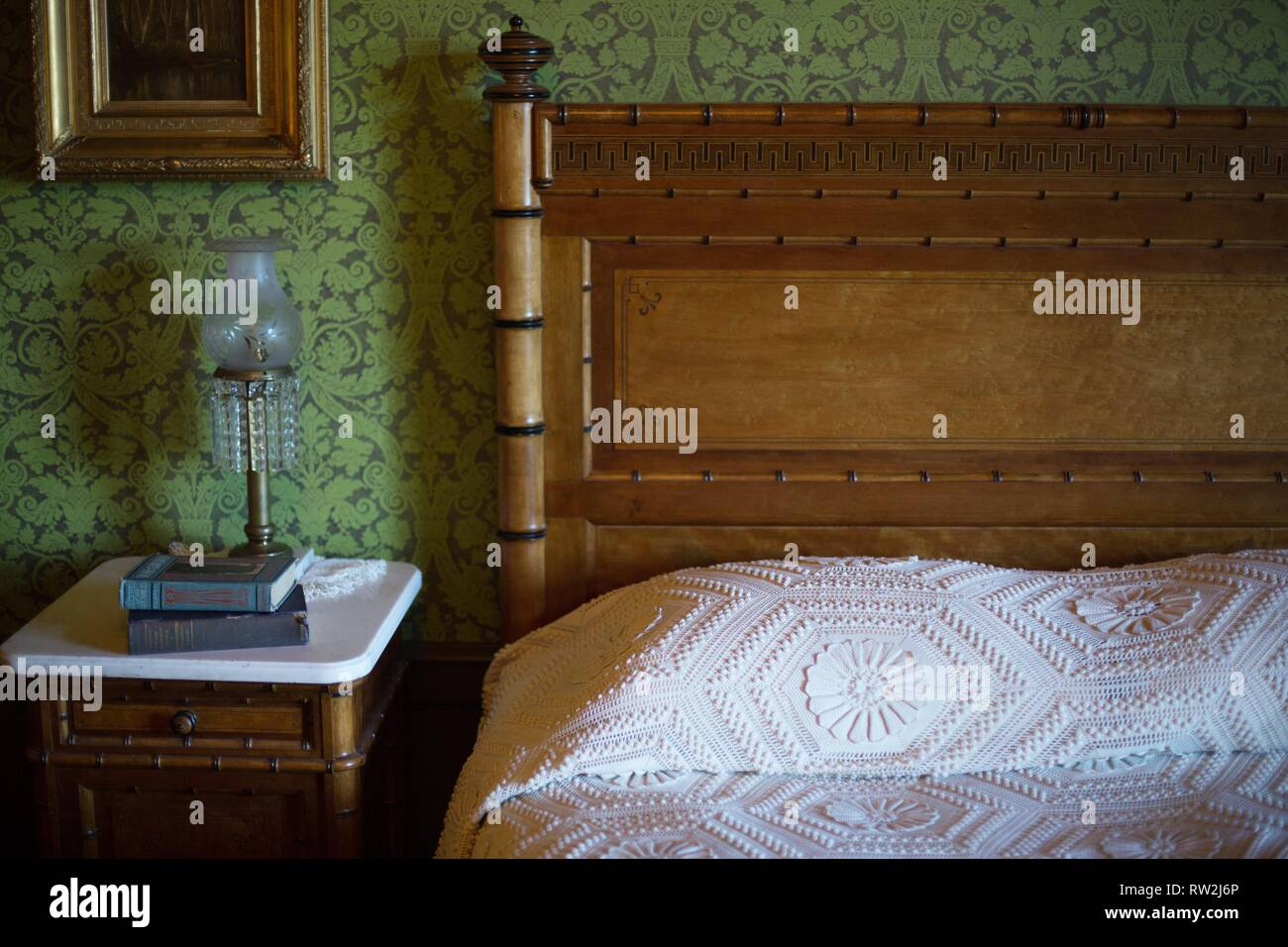 A bedroom with green wallpaper, at Pittock Mansion in ...