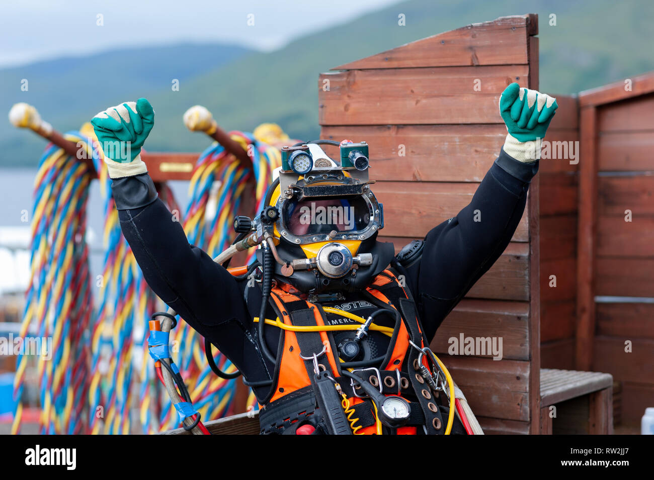 Trainee divers practise their skills in all aspects of the trade from welding to diving plus buddying.Fort William Scottish Highlands Scotland UK Stock Photo