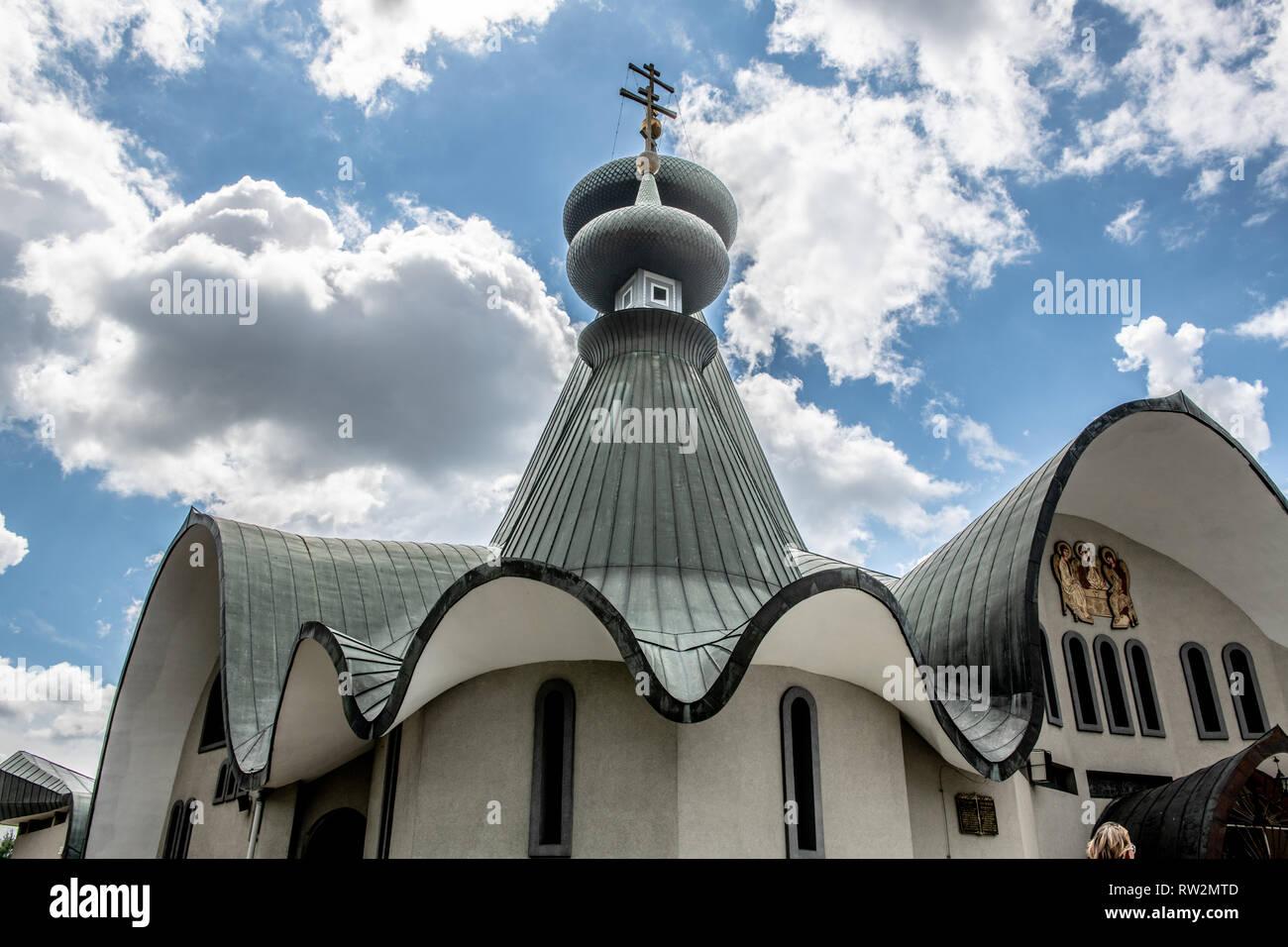 Wavy roof and spire on top of Sabor Sviatoj Trojcy, Orthodox church,  Hajnówka Poland. - Stock Image