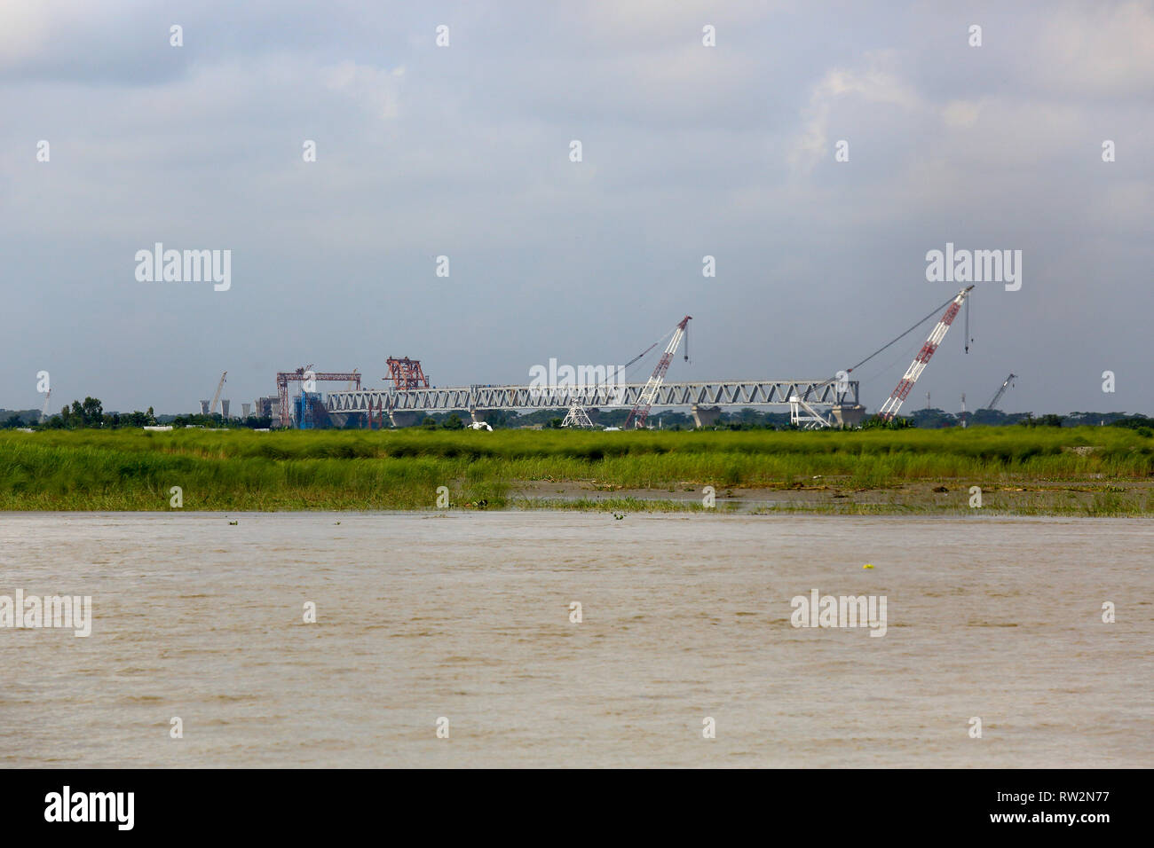 Bridge construction work in progress on the Padma River. Bangladesh. - Stock Image