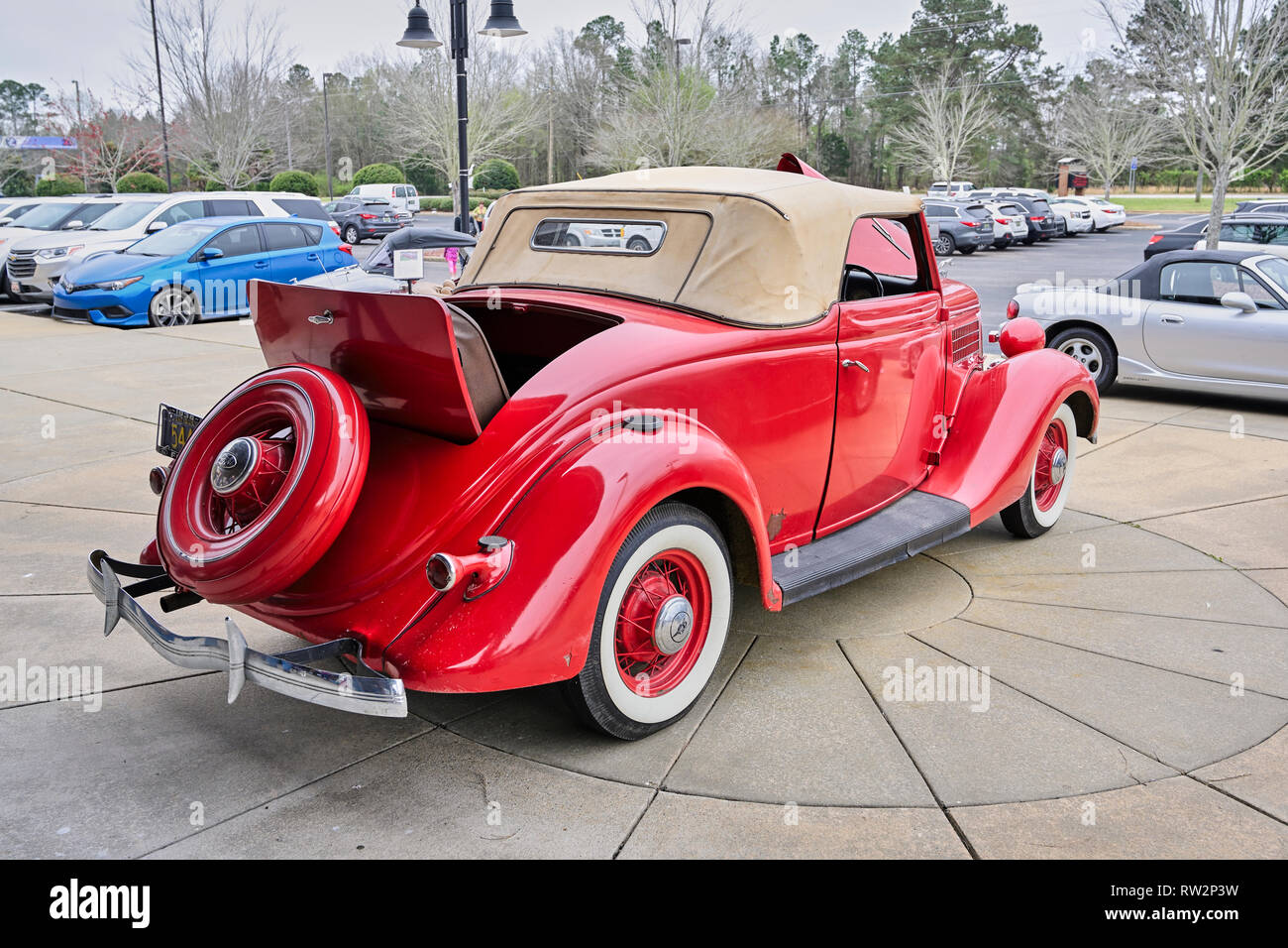 Red classic or vintage Ford 48 Roadster with an open rumble seat and covered spare tire on display at a vintage car show in Pike Road Alabama USA. Stock Photo