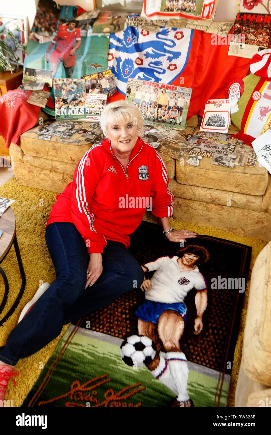 Joanne, from Gloucestershire, has been a life long 'superfan' of Kevin Keegan, amassing a huge collection of press cuttings, photos and memorabilia ab - Stock Image