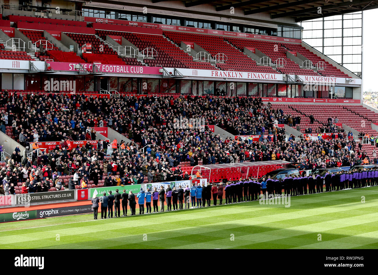 Stoke City fans, players and staff applaud as the Gordon Banks funeral cortege passes through the bet365 Stadium, Stoke. Stock Photo