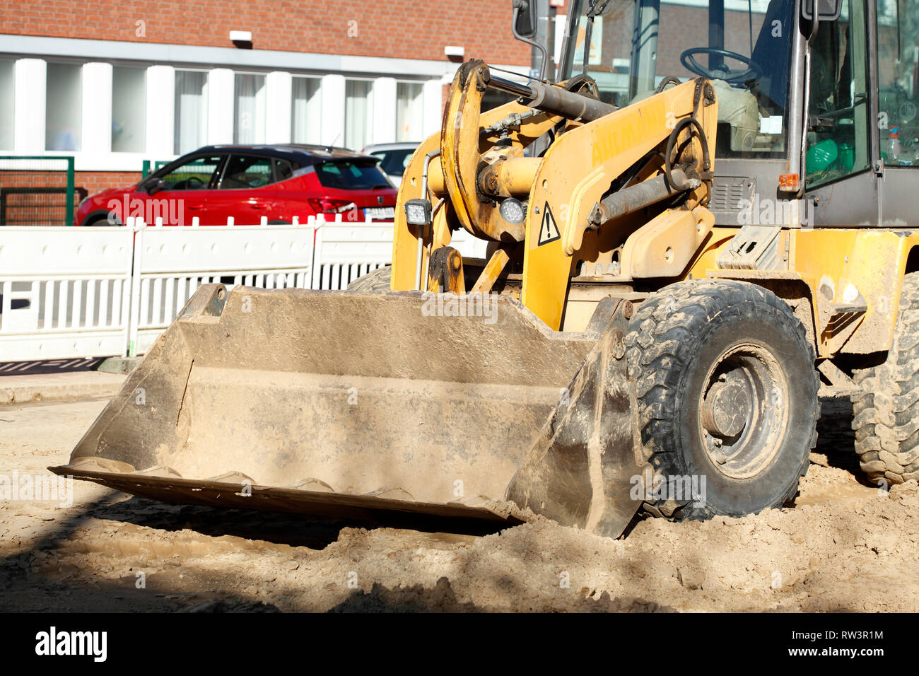 Excavator with excavator bucket on a construction site - Stock Image