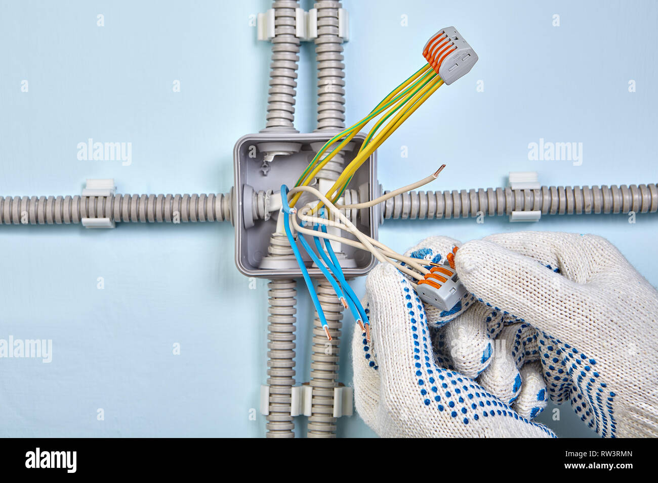 Super Electrician In Protective Gloves Uses Pluggable Terminal Block To Wiring 101 Sianudownsetwise Assnl