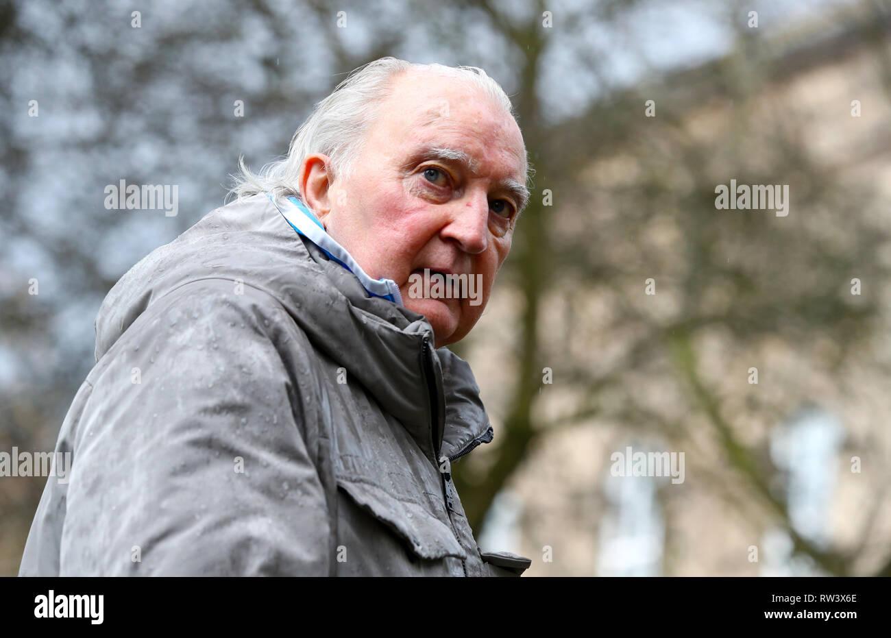 Retired footballer Alan Hudson arrives at the funeral service for Gordon Banks at Stoke Minster. - Stock Image