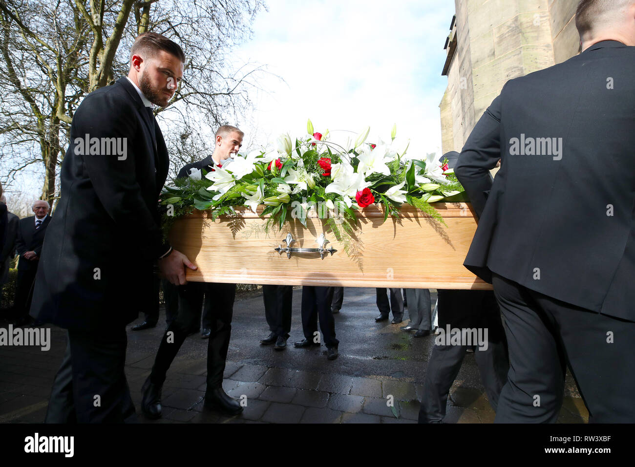 Stoke City goalkeeper Jack Butland (back left) and Burnley goalkeeper Joe Hart carry the coffin during the funeral service for Gordon Banks at Stoke Minster. - Stock Image