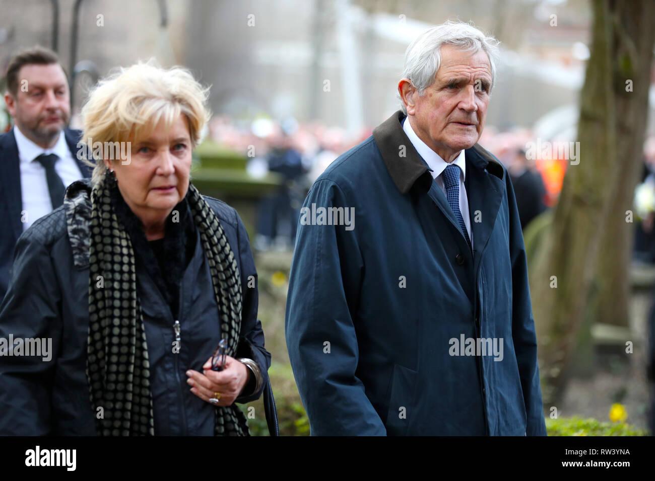 Retired footballer Norman Hunter arrives at the funeral service for Gordon Banks at Stoke Minster. - Stock Image