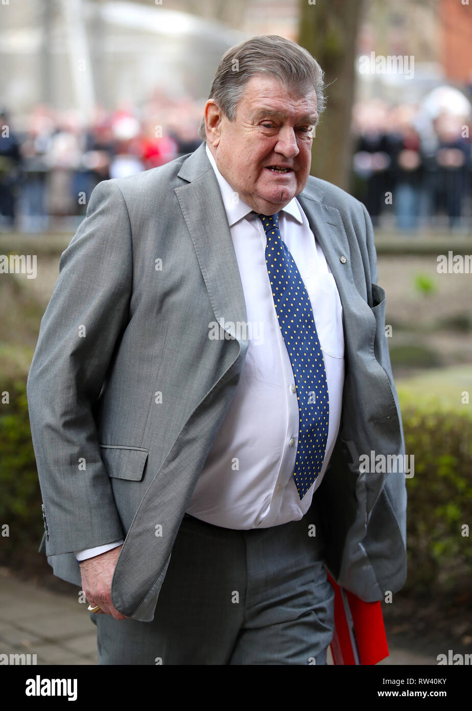 Sports journalist Stephen Curry arrives at the funeral service for Gordon Banks at Stoke Minster. - Stock Image