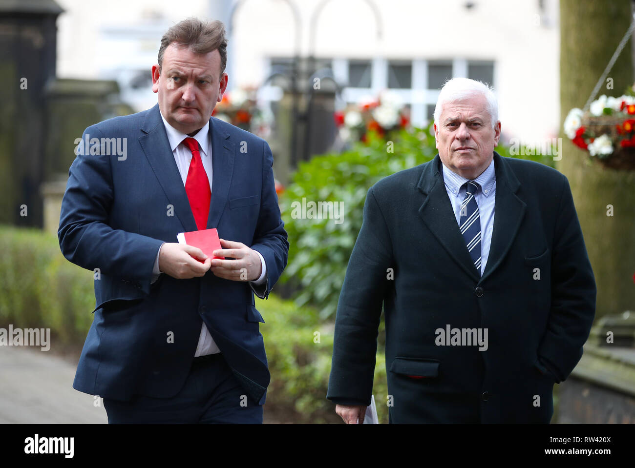 Nicholas Randall (left) and Peter Ridsdale arriving at the funeral service for Gordon Banks at Stoke Minster. - Stock Image