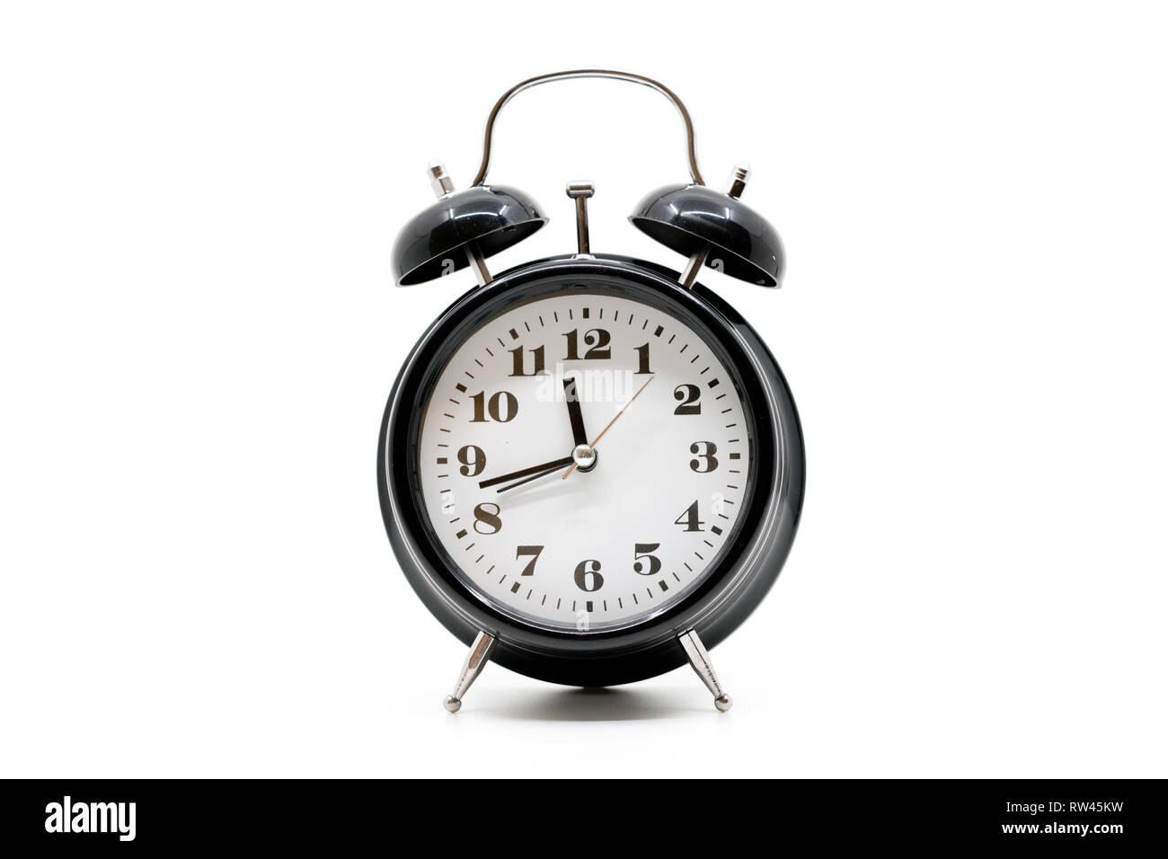 Black alarm clock on white background - Stock Image