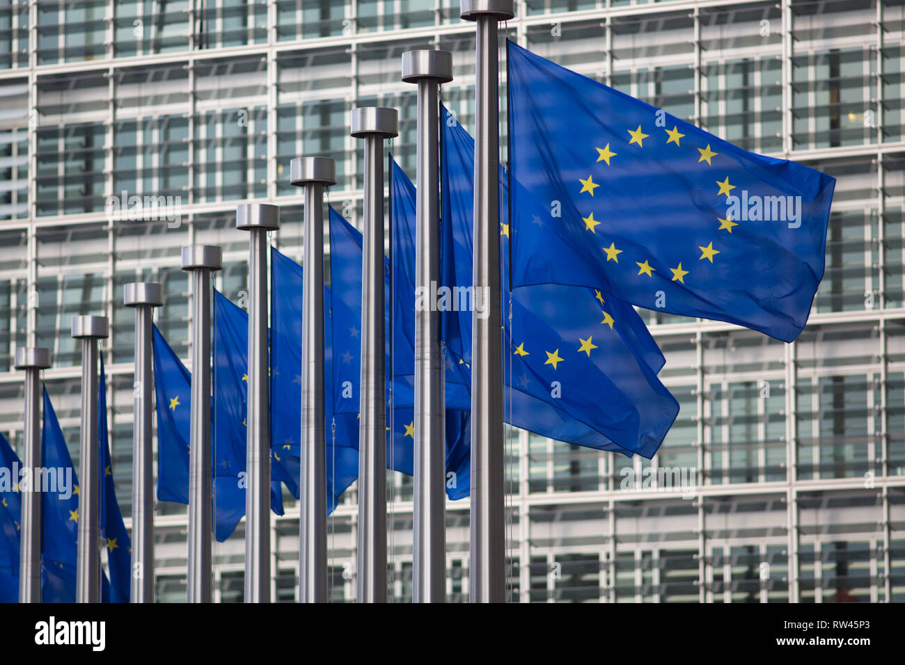 European Union flags in front of Berlaymont building - Stock Image