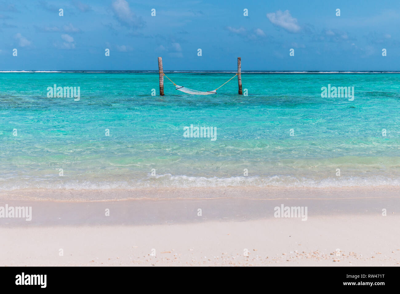 Hammock in the water on the maldives - Stock Image