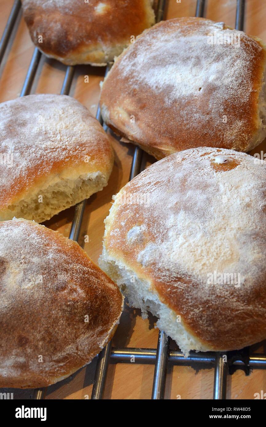 fresh rustic bread rolls, Delicatessen food - Stock Image