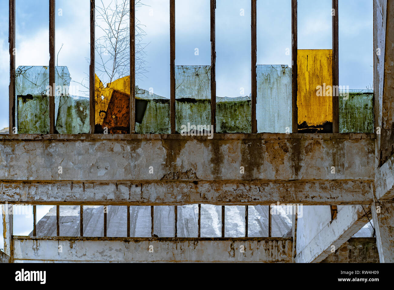 Broken window in abandoned chemical fiber factory - Chemitex - Stock Image