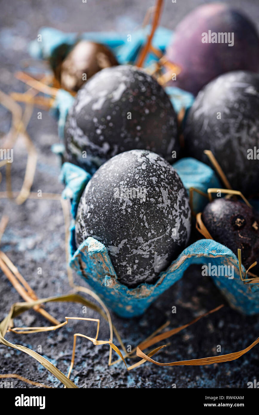 Easter painted chicken and quail eggs with stone or marble effect - Stock Image