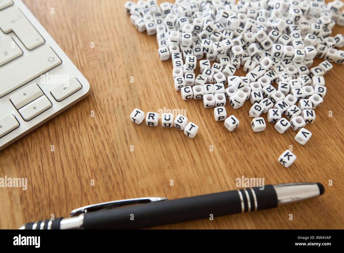 Trust word written on cube shape white blocks on wooden Business table Stock Photo