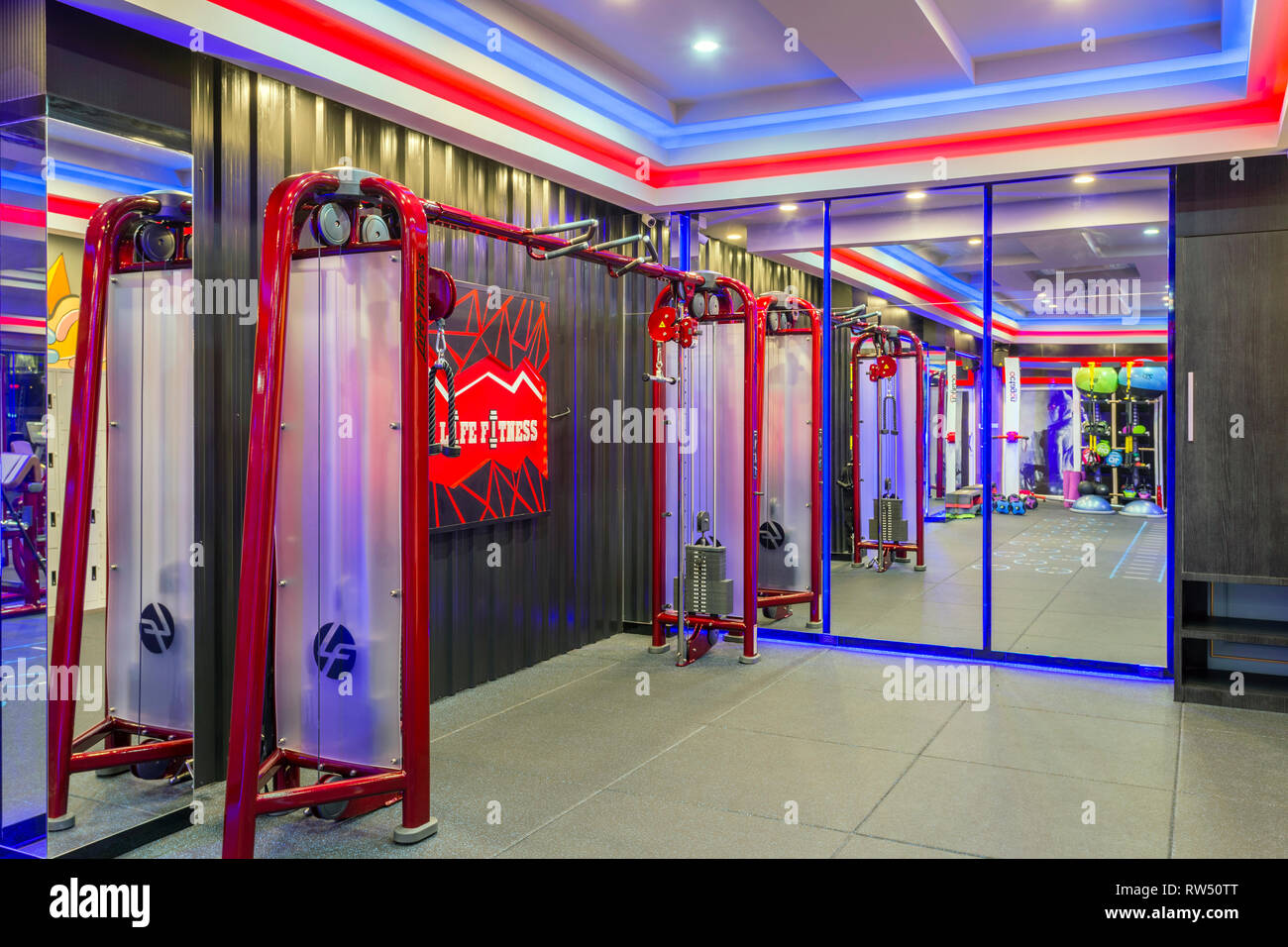 GM Life Fitness health club interior room filled with fitness equipment and exercise machine in Krabi, Thailand. - Stock Image