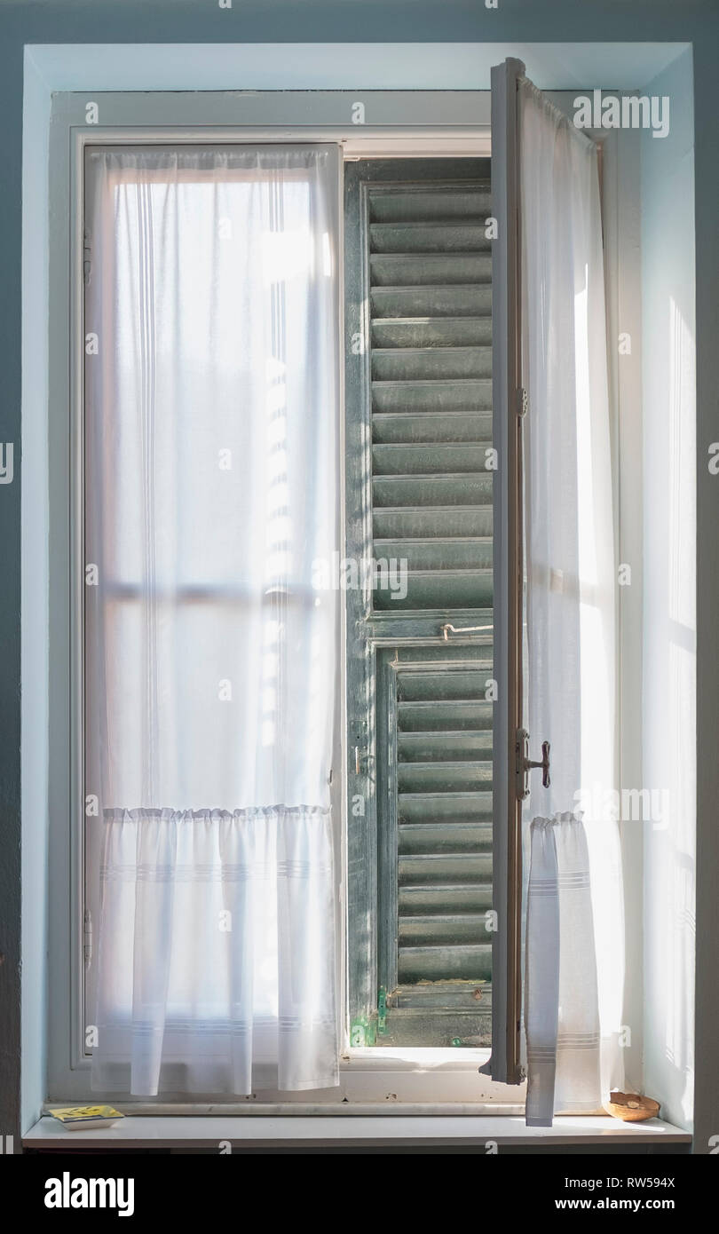 A Half Open Window With Shutters Viewed From Inside Stock