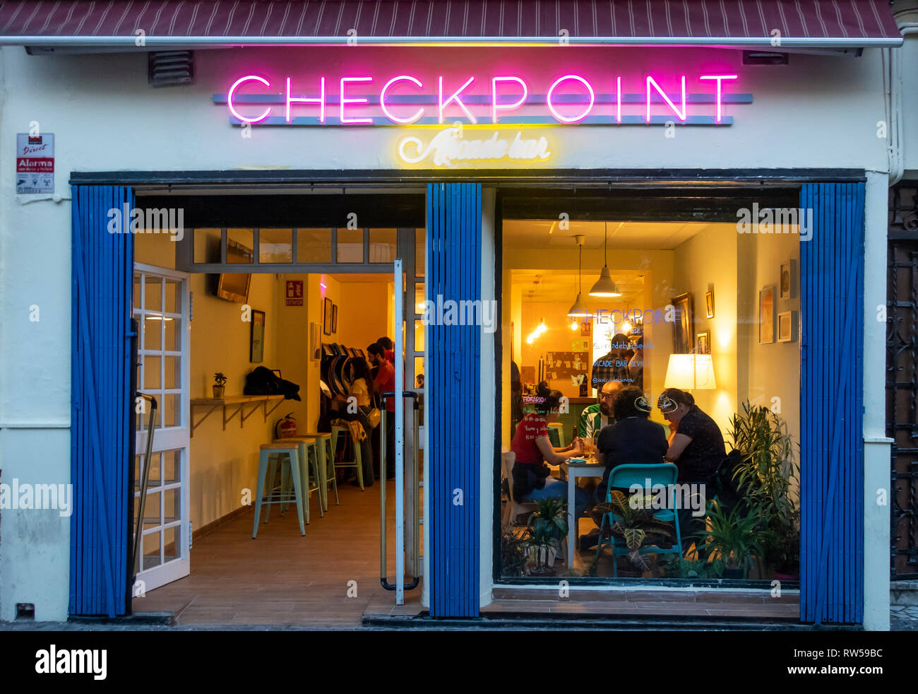 Checkpoint Arcade Bar, a place to play games and a have a drink and a snack in Seville, Spain - Stock Image