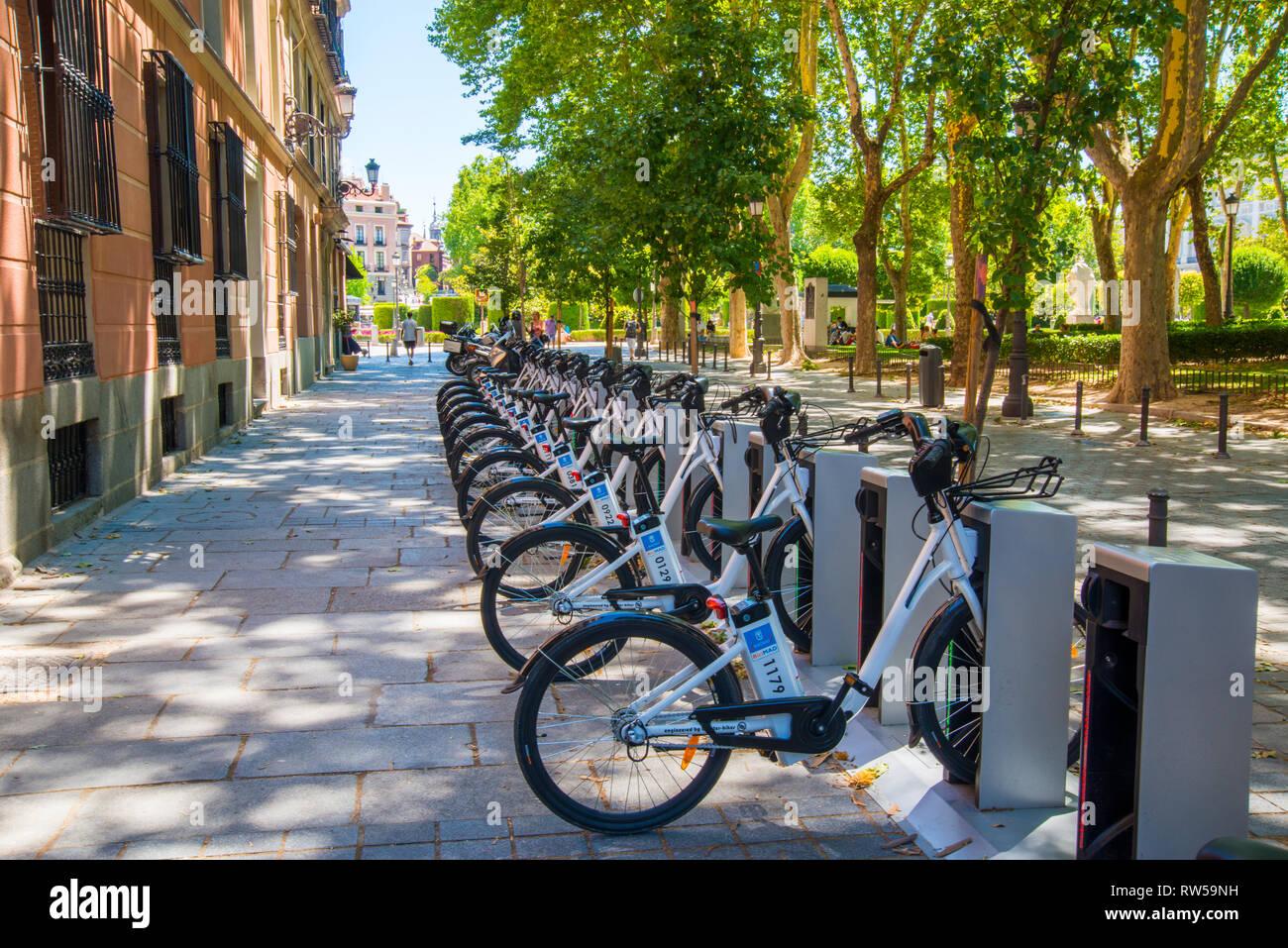 Hire bikes parking. Plaza de Oriente, Madrid, Spain. - Stock Image