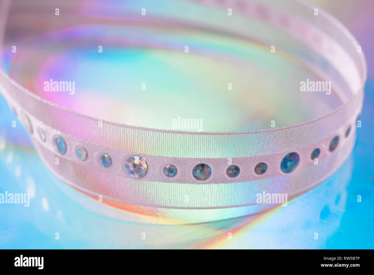 Ribbon on holographic paper - Stock Image