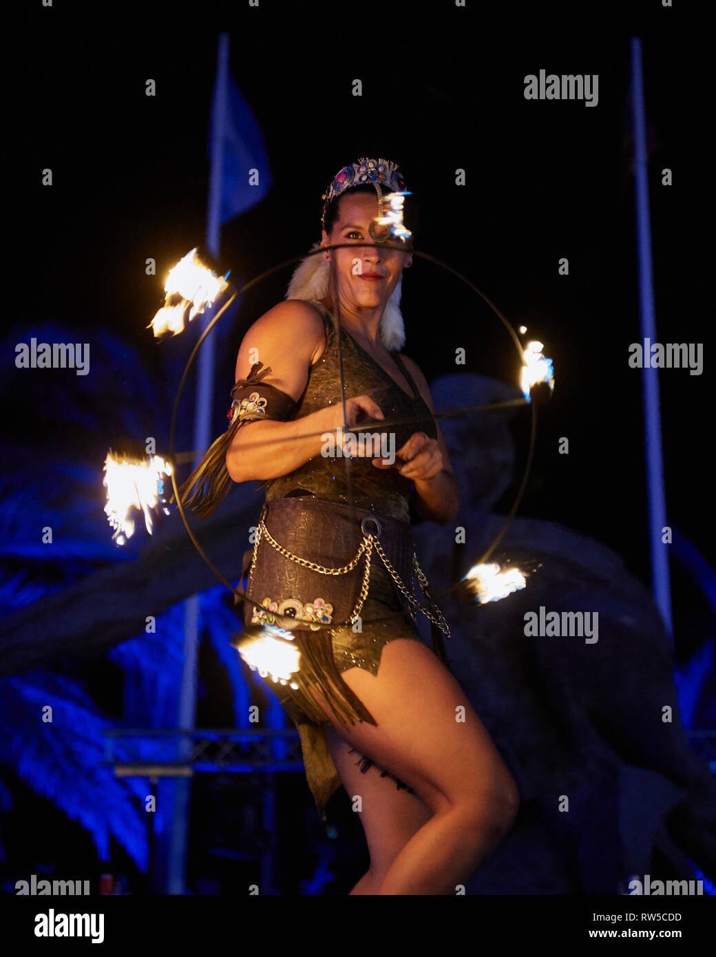 Full Moon Party - The unique Luna Llena De Manilva festival.  A beautiful sight, with attendees dressed in white and fire juggling entertainers. - Stock Image