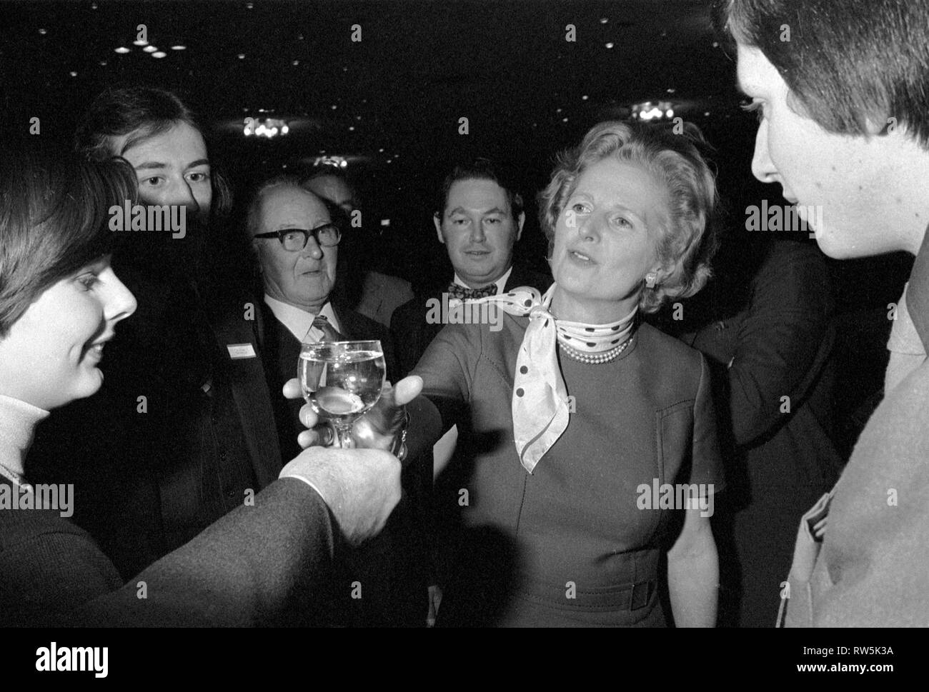 Margaret Thatcher campaigning for the 1979 General Election in Northampton.  Meeting local Conservative Association members. In background Northampton South tory MP Michael Morris who is now Baron Naseby of Sandy. She is receiving a glass of water. 1970s UK HOMER SYKES - Stock Image