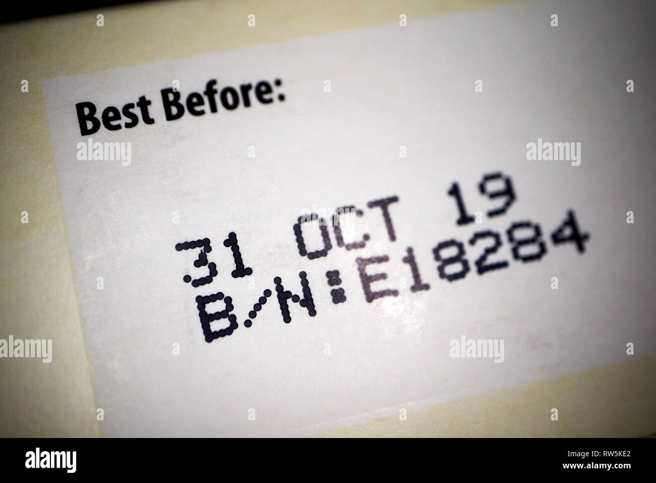 dot matrix printed best before label on food packaging - Stock Image