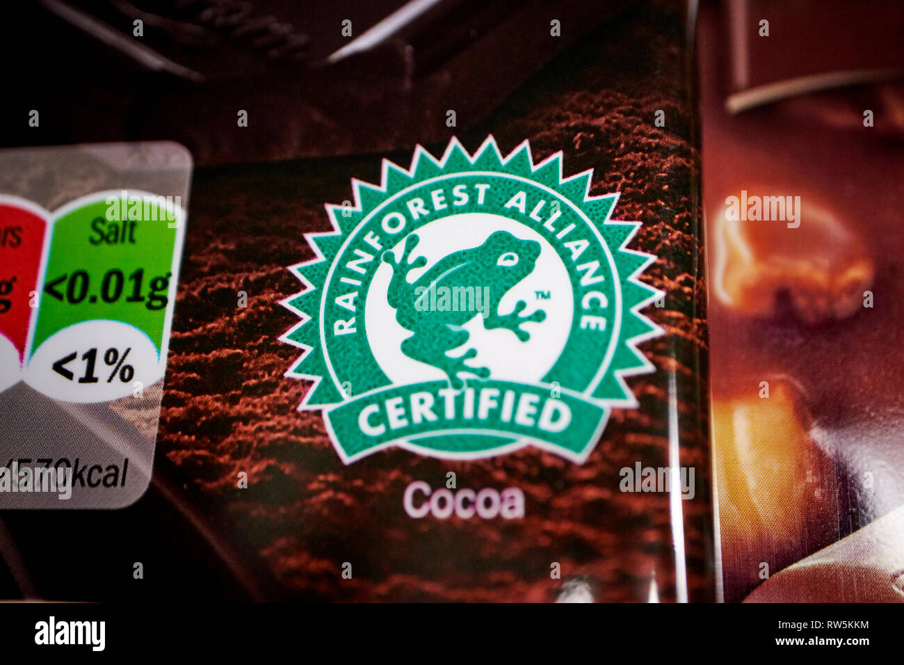 rainforest alliance certified cocoa label on a bar of chocolate - Stock Image