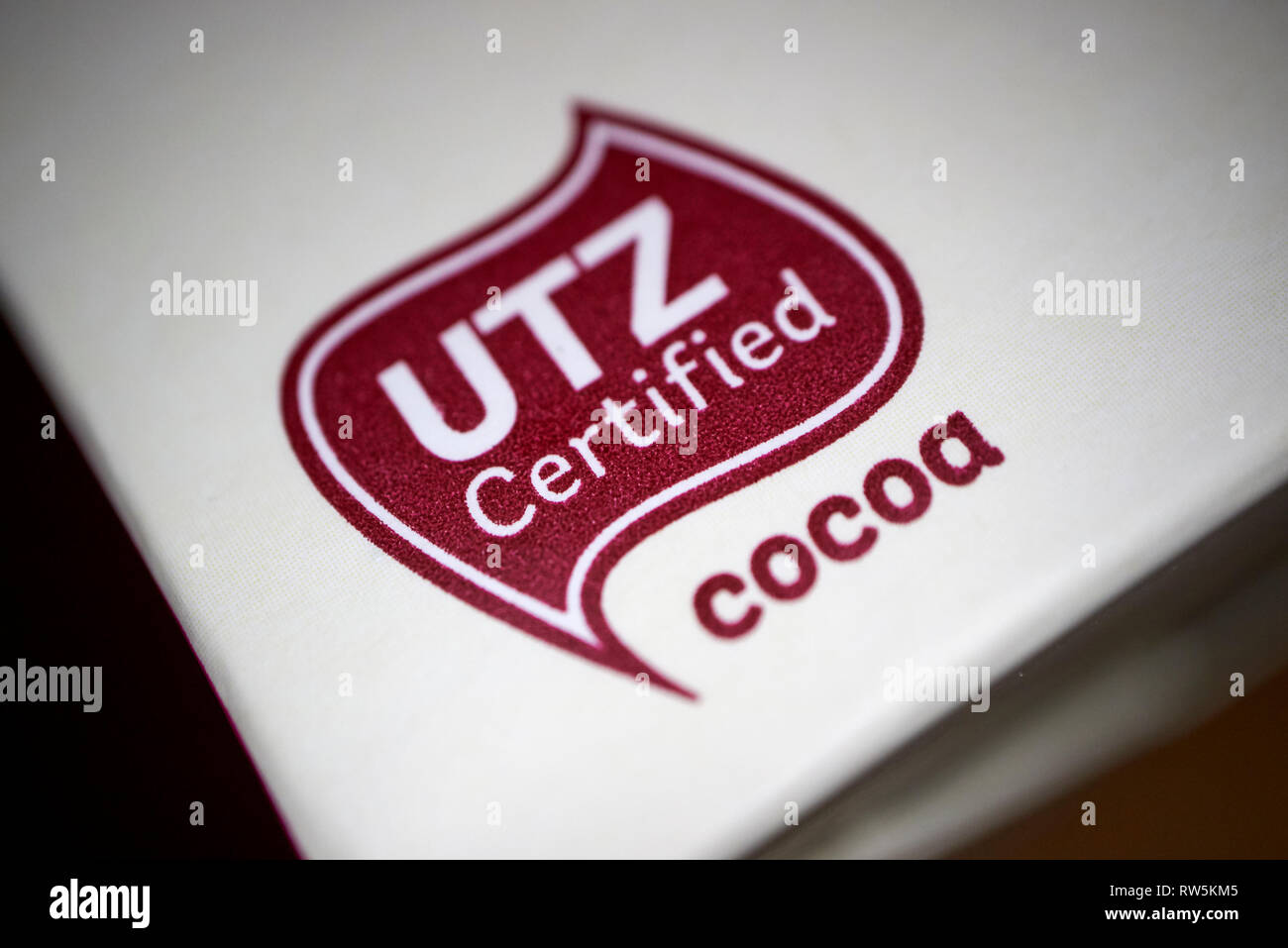 UTZ certified cocoa label on a bar of chocolate - Stock Image