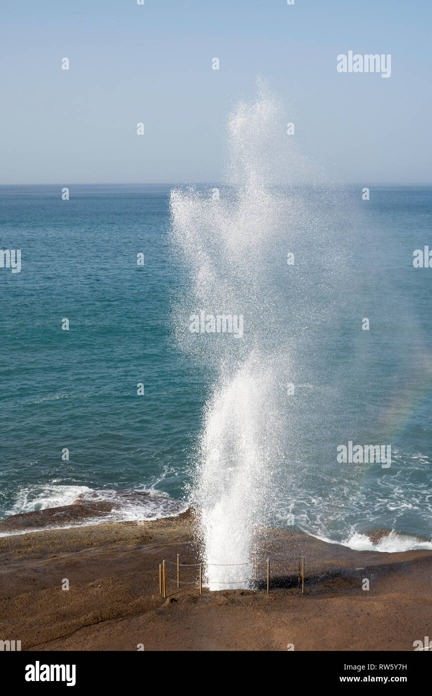 A water spout erupting from a blowhole or marine geyser at Costa Adeje, Tenerife, Canary Islands. Stock Photo