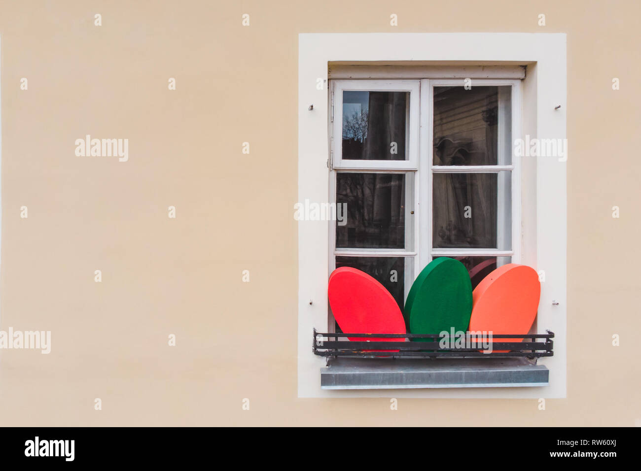 easter decoration eggs on building window. christian holidays - Stock Image