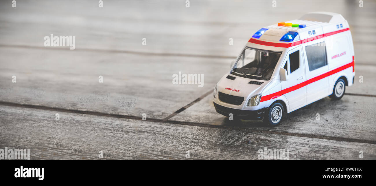 ambulance horizontal background health care toy sirens blue lights copy space - Stock Image