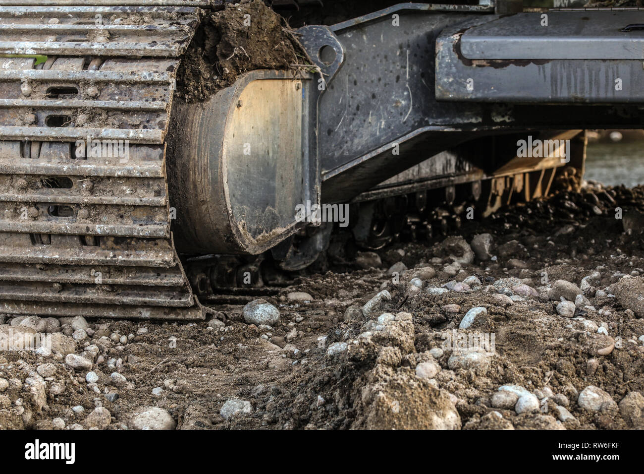 Heavy Excavator Digger Machine Track Detail Some Stones In Foreground Abstract Industrial Construction Background Rw Fkf