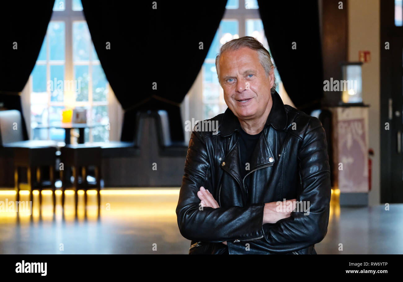Dresden, Germany. 15th Feb, 2019. Jörg Stempel, former head of the GDR record company Amiga, sits in the boulevard theatre at the press event. The premiere of the play 'The Legend of Hot Summer' will take place there on 10.03.2019. The theatre show is about the 'Sound of the East'. (to dpa ''hot summer': Dresden stage show celebrates the sound of the east') Credit: Sebastian Willnow/dpa-Zentralbild/dpa/Alamy Live News - Stock Image