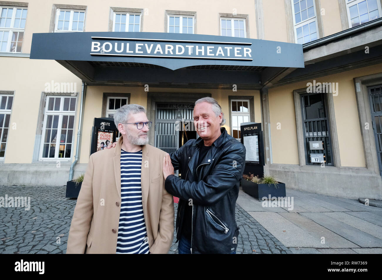 Dresden, Germany. 15th Feb, 2019. Jörg Stempel (r), former head of the GDR record company Amiga, stands with Olaf Becker, artistic director of the boulevard theatre, at the press meeting in front of the venue. The premiere of the play 'The Legend of Hot Summer' will take place there on 10.03.2019. The theatre show is about the 'Sound of the East'. Credit: Sebastian Willnow/dpa-Zentralbild/dpa/Alamy Live News - Stock Image