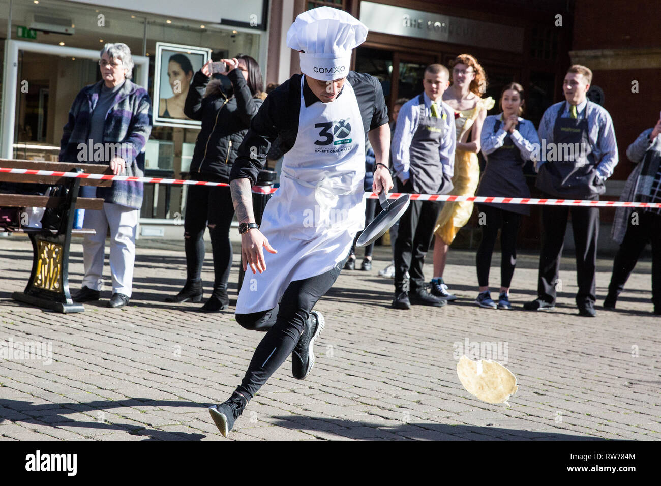 Windsor, UK. 5th Mar, 2019. Competitors in fancy dress on the theme of a '15th century housewife' from local businesses show off their flipping skills and fancy footwork as they take part in the 13th Windsor and Eton Flippin' Pancake Challenge on Shrove Tuesday in aid of Alexander Devine Children's Hospice Service and Windsor Homeless Project. Credit: Mark Kerrison/Alamy Live News - Stock Image